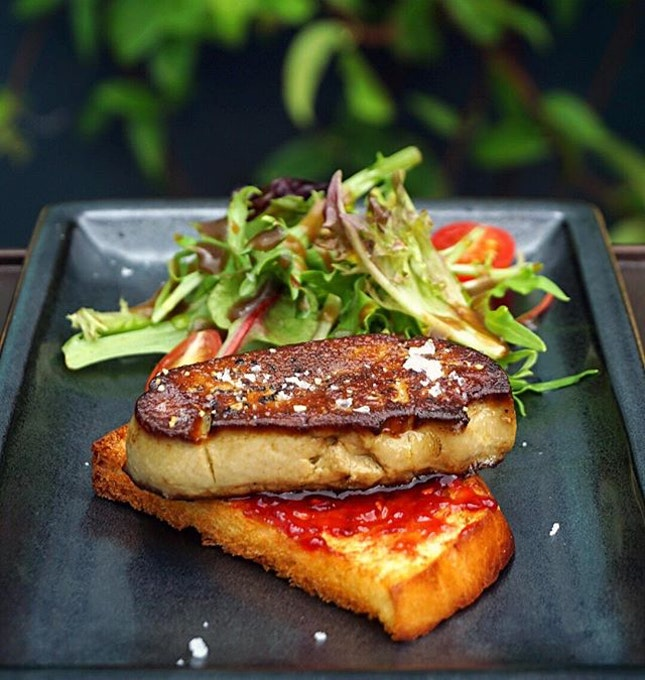 Classic Foie Gras ($16.90) Pan fried foie gras served atop toasted brioche with a fruit jam spread alongside petit salad.