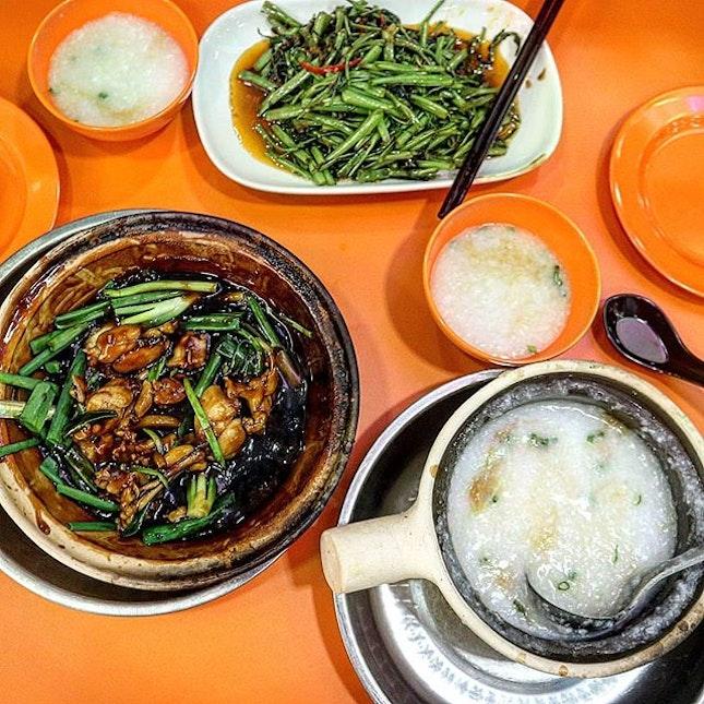 Claypot Porridge accompanied by spring onion ginger frog legs and sambal kangkong.