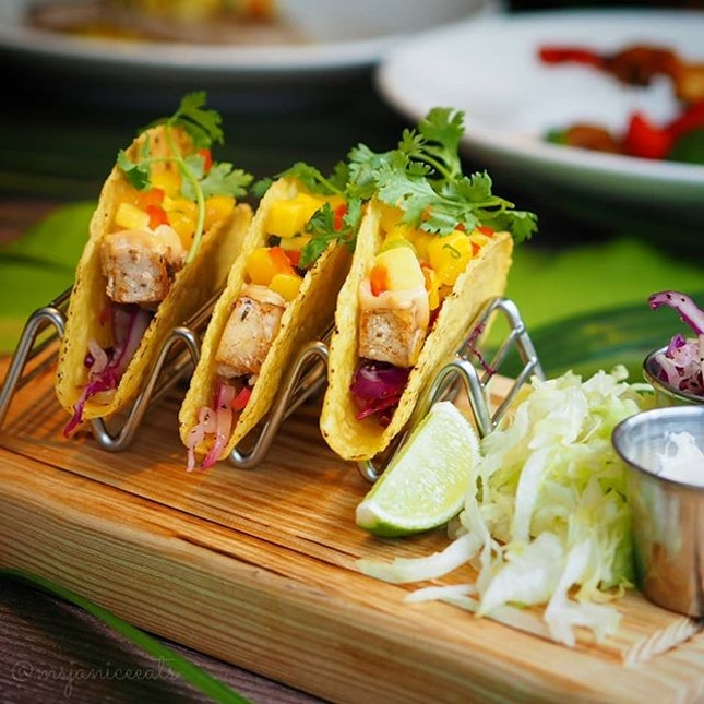 ⭐ [LIMITED-TIME MENU] Hard Rock Café ~ Taste of Tropicana ⭐  1) Mahi-Mahi Fish Tacos (S$29.95): Pan-fried Cajun mahi-mahi in tacos with slaw and mango salsa.  These tacos are so delicious that you probably won't stop at one!