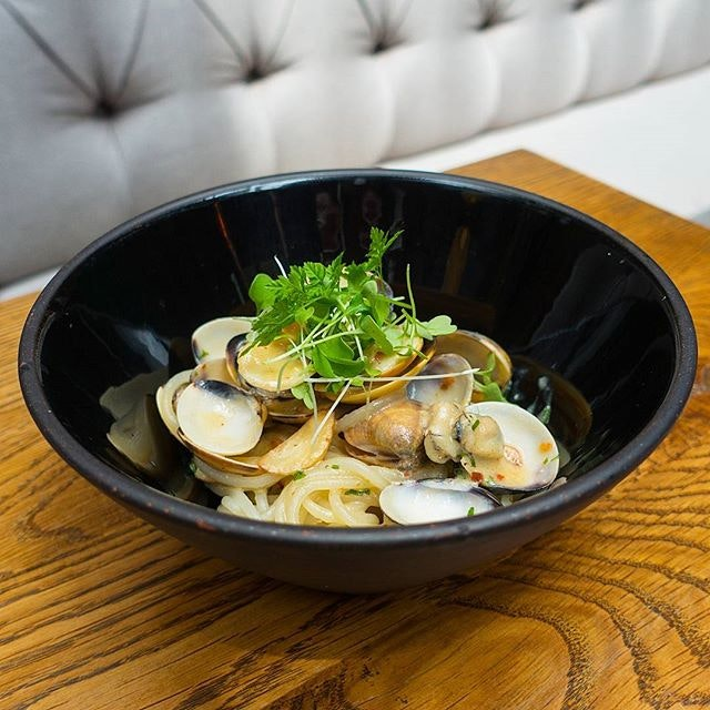 @opendoorpolicysg Gluten-free Spaghetti Vongole, prepared with rice flour stra­nds well coated with fragrant and creamy Japanese white miso sauce.