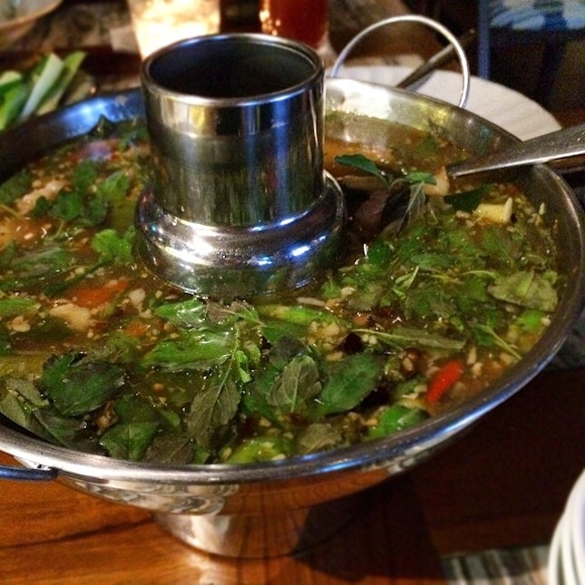 ; Tom Yum  Hot and sour soup of chicken wings and feet, served in a mini steamboat wok, no less!