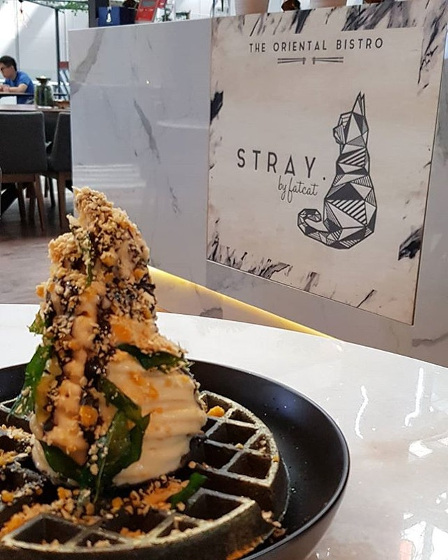 Black & Gold - Their signature charcoal waffle with salted egg yolk soft serve and cereals.