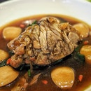 New CNY item at Cherry Garden featuring the Braised Pig's Trotter with braised 6-head abalone and black moss.