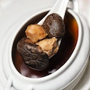 Double-boiled Sea Whelk with Black Garlic in Sakura Chicken Consomme