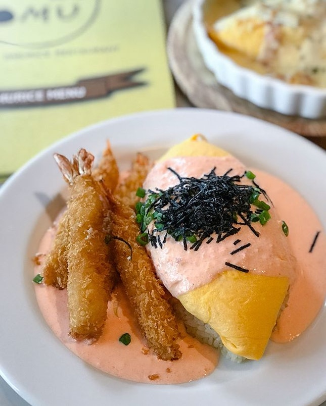 Mentaiko cream sauce omurice [$13.80] with lava egg [+$2] and deep fried shrimps [+$5] .
