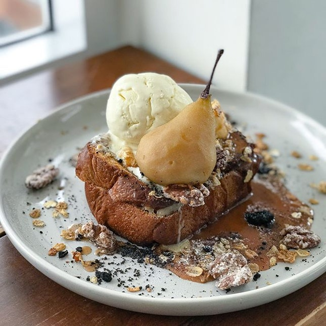 Salted pear french toast [$18] with vanilla ice cream [+$3] .