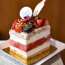 Strawberry watermelon cake [$8.90] Managed to be one of the lucky ones to grab the remaining last few slices left on their last day of operations for 2018!✌🏻Comprising of a wedge of fresh, juicy and sweet watermelon sandwiched within two thick layers of rose-scented light pastry cream along with light and fluffy dacquoise-alike layers, the cake is also topped with fresh strawberries and grapes.