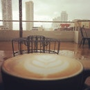 A cup of coffee before leaving through the heavy rain.