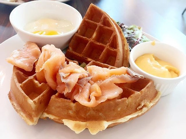 Salmon Waffles $12.90  Smoked salmon, poached eggs, cheese sauce and some bunny food.