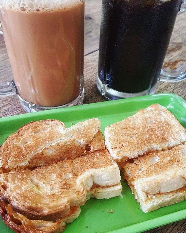 [Indonesia - Medan]  Classic breakfast with Kaya Toast (IDR 24,000) and Teh Tarik (IDR 34,000) for me and Kopi (IDR 30,000) for him.