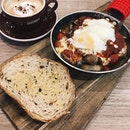 one of my new fav cafes (???) for brunch — skillet baked eggs w grilled veges + a cappuccino 🤤 both food n coffee r really good, n i love dipping the garlic buttery toasted multi grain bread into the gooey yolk n tomato saucey mixture!!
