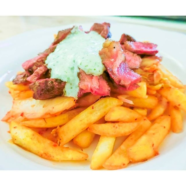 Kimchi Fried with Grilled Steak and Gilantro Mayo at @papercranesg The generous amount of Kimchi fries with actual kimchi that is topped with perfectly done medium-rare steak under some really delicious cilantro mayonnaise.