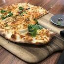 Thin crispy crust Cajun salmon pizza 🍕 and I love their ceramic plates and soup bowls #commonsgrounds #burpple #burpplesg #sgfood #sgfoodie