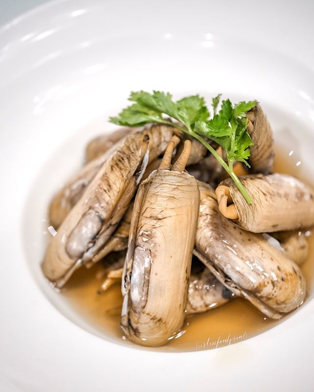 Chilled DUOTOU Clam in Fermented Wine ($22.80).