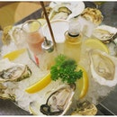 Fine De Claire Oysters and Irish Oysters with truffle oil, whisky and shallot sauce.