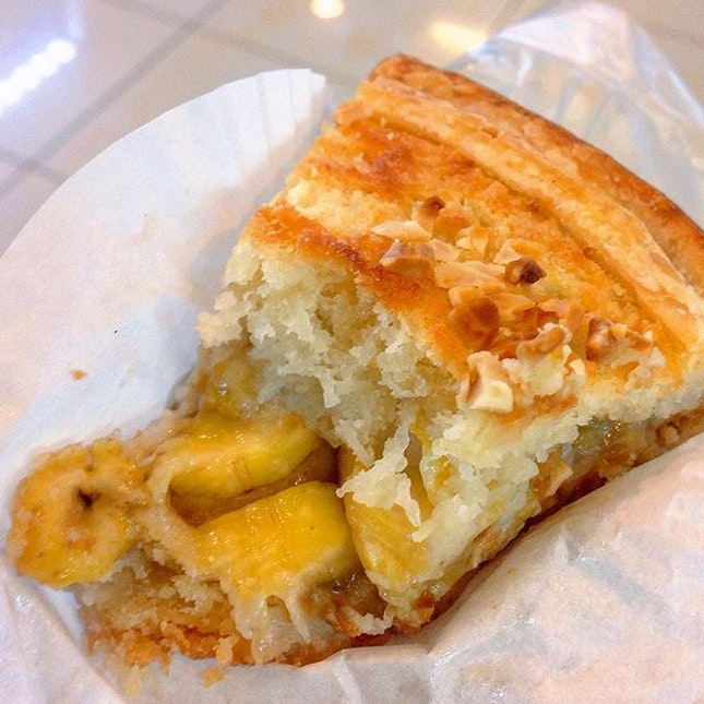 [Dona Manis Cake Shop] Can never resist the golden brown banana pie topped with almond bits from Dona Manis!