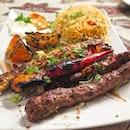 Mixed Grilled Platter consists of lamb kofta, chicken kofta, lamb mashwi and shish tawok.