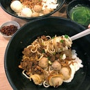 Traditional KL chilli ban mian is served with minced meat, poached egg, meatballs, ikan bilis, a bowl of spinach soup.