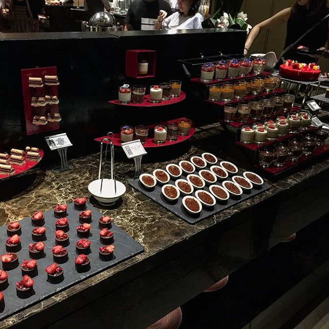 Cheese and chocolates buffet with a beautiful night view.