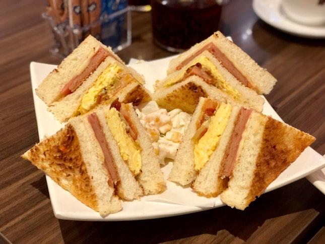 Club Sandwich with cocktail salad
