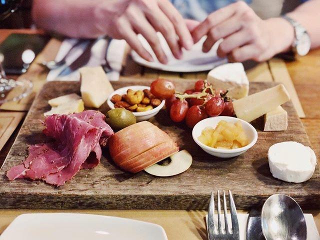 Wine, cheese platter & bread.
