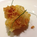 A chunk of Spiny Lobster with julienned Kaffir Lime Leaf.