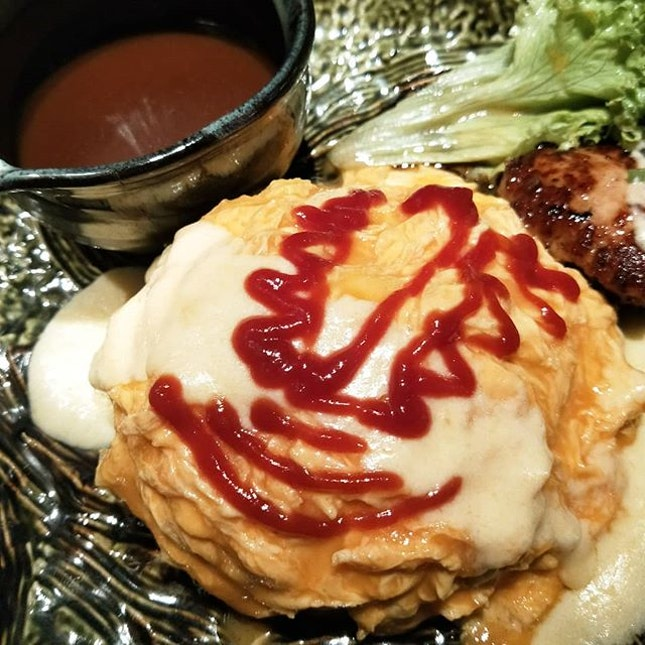 Omurice, cheese and hamburg with demi-glace sauce ($14.90) | When latte art is too mainstream, I do tomato art instead .