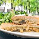 Truffle infused mushroom cheese toast .
