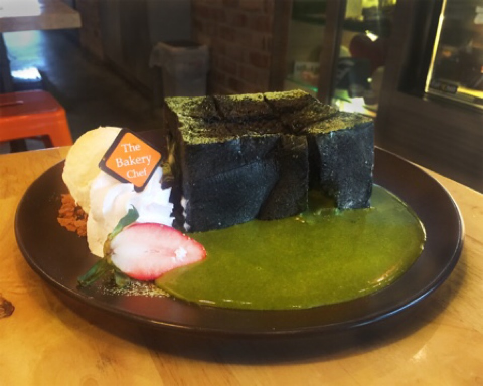 Charcoal Lava Toast with Salted Egg Matcha Filling ($13)