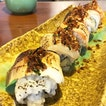 Sanshoku aburi roll topped with salmon, scallop and yellowtail.