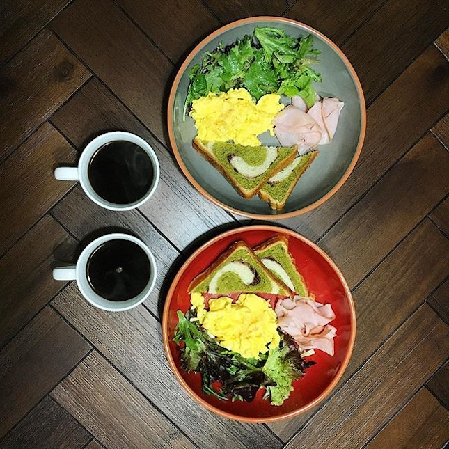 Breakfast: Matcha azuki loaf, shaved honey baked ham, scrambled eggs, mesclun salad, black coffee.