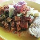 Sambal Goreng Nasi x Sambal Cuttlefish x Tempeh, with a generous serving of curry gravy and veggiess.