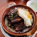 Pickled braised pork claypot rice.
