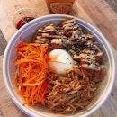 Chicken Karaage with Tonkatsu Mayo Bowl — Koshikari rice with homemade tare sauce, cucumber and carrots with chia seeds goma sauce, onsen egg and tonkatsu mayo.