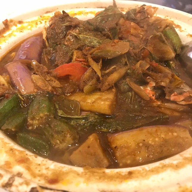 Asam curry fish head