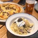 Truffle Carbonara Pasta ($22) and Sweet Aloha thin crusted pizza ($22).