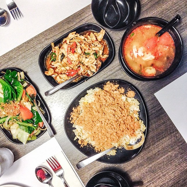 Tom yum seafood soup ($9.50), basil stir fry chicken ($12.50), mixed vegetables ($9.50) and pineapple rice ($9.50).