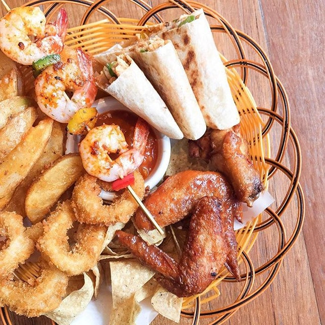 Sharing a platter of finger food at Muchos with the family.