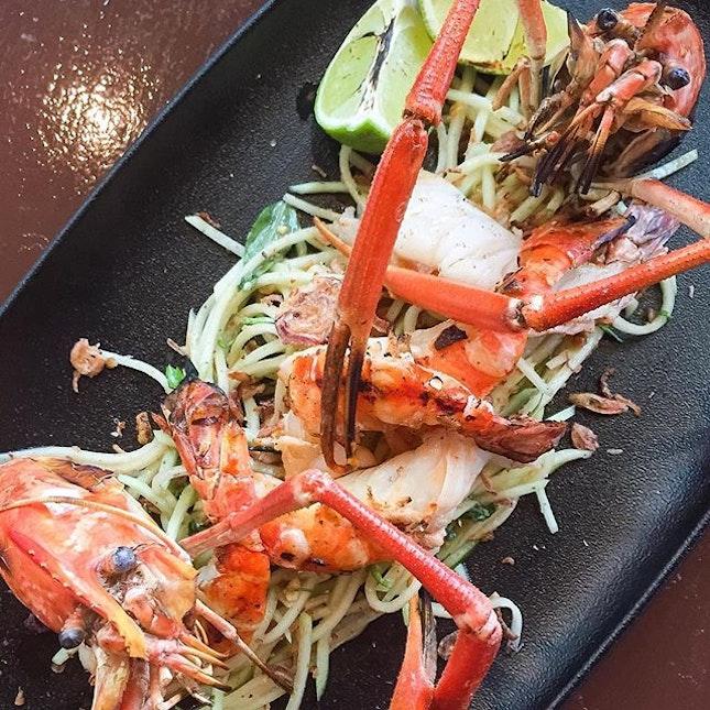 Grilled big head prawns with papaya salad, fried peanuts and tamarind dressing ($27).