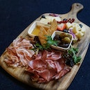 Tagliere Misto This lovely platter of Artisanal Cured Meat comes with olive, Pickles and homemade Foccacia Bread.