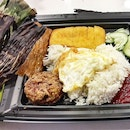 Sundays mean a little indulgence at Crave Nasi Lemak - otah, egg, chicken wing and fish cake.