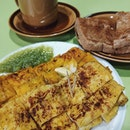 Enough a piece of quiet with slices of 🍞and a cup of rich, slightly bitter ☕ (Photo: Old school HaiNam style kopi with toast)  #amoystreet #kopi #frenchtoast #kayatoast #jdkungfoodhunt #burpple