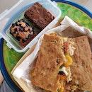 Focaccia Sandwich ($10), Financier ($5), Hazelnut & Almond Brownie ($5.50)