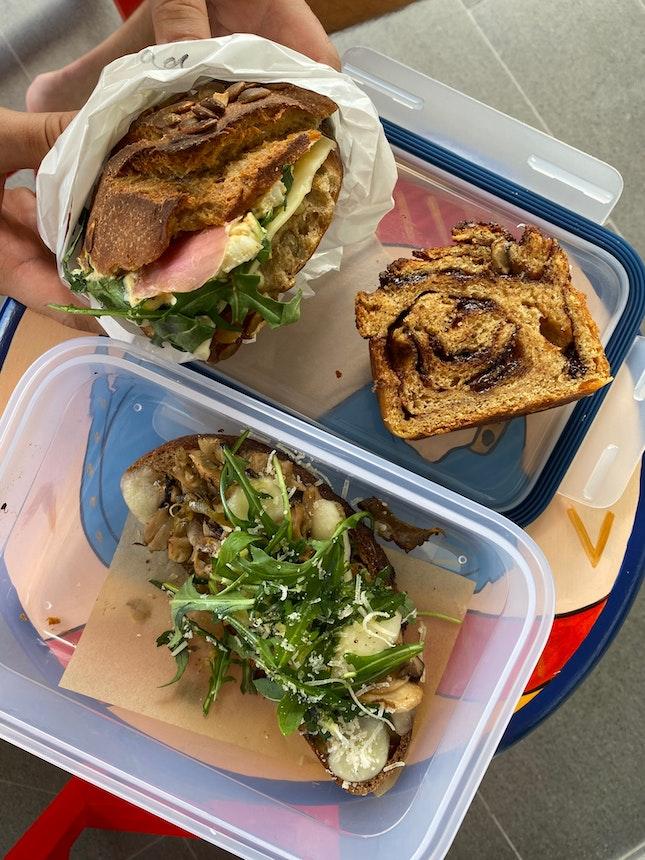 Egg Salad Sandwich Roll ($9), Chocolate Raisin Babka ($3.50), Roasted Mushroom Terrine ($8)