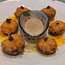 Sautéed Stuffed Button Mushroom With Truffle Sauce ($10)