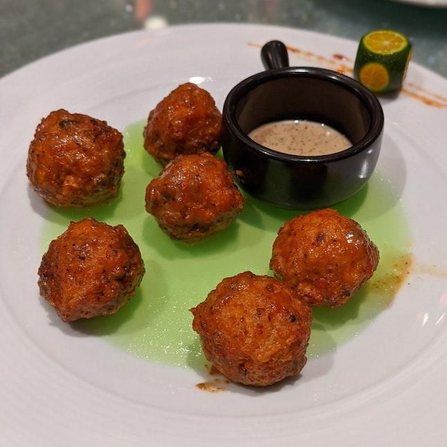Sauteed Stuffed Button Mushrooms With Truffle Sauce ($14)