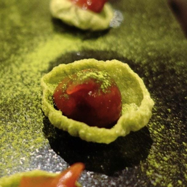 Green tea puffed rice tuile with candied rhubarb.