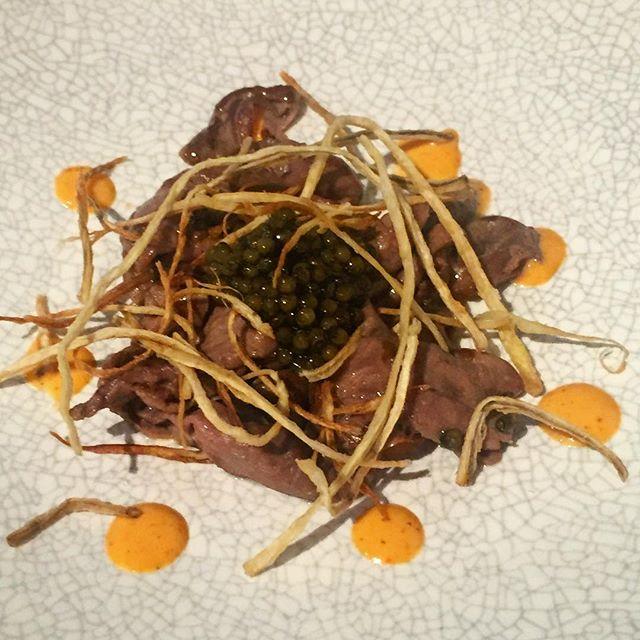 Veal hearts, burdock root, caviar and homemade sriracha sauce.