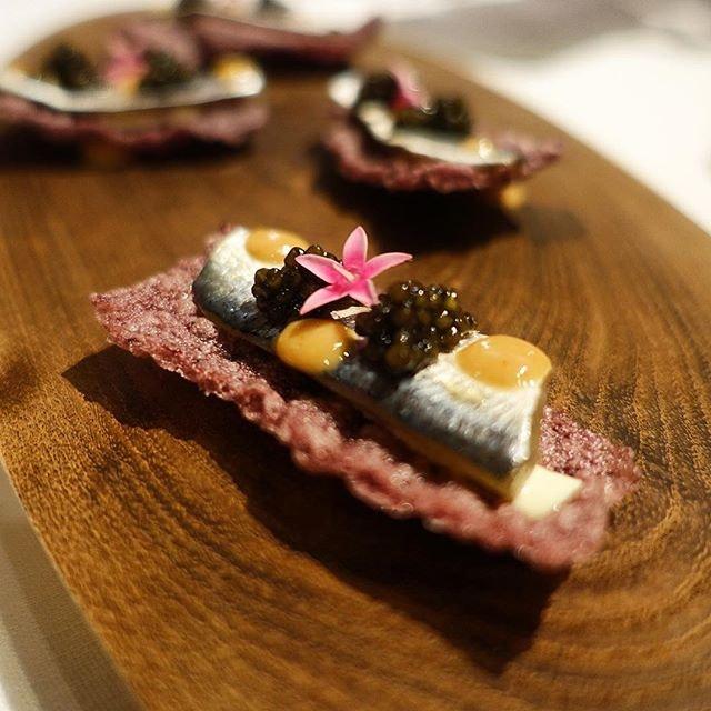 [Gallery Vask] Sardines on a lovely, lovely purple rice cracker.
