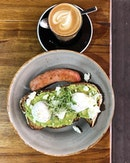 Smashed avocado and pork fennel sausage, with a cuppa of Australian coffee.